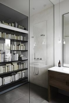 Fascinating idea:  the back of a bookcase is behind glass and is one wall of the shower; clever:    desire to inspire - desiretoinspire.net - Templeton