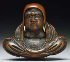 """The center figure is a representation of Bodhidarma, also known as Daruma or Tamo. The traditional Daruma figure is a balanced figure that will not stay down if knocked over, it will right itself automatically. This automatic righting is representative of the Buddhist saying """"Seven times down, eight times up"""". This is a common saying among early Jidokwan members. Traditional Daruma gourds, painting, wood carving, ceramic and window shutters from a temple all show the Otugi style."""