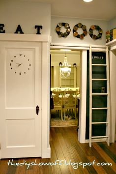Kitchen decor....Clock pantry door, Wooden letters sitting on door frame, Chalk board wall, & Ladder to the Spices.