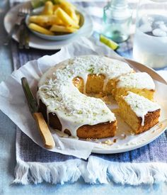 Lime and coconut cake with pineapple glaze recipe - Preheat oven to 180°C. Butter the base of a 25cm-diameter ring tin and line with baking paper.