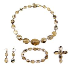 1820 Moss agate parure,  All in open cut-down collet settings set in gold.  SJ Phillips