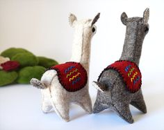 Dimensions of each Llama : Height: 14.5 cm. / Width : 5 cm. / Length : 9.5 cm I introduce you to two LLamas that were born to be together and thats why come in this kit. Shes Celeste and his alter ego. Two creatures of felt wool, hand-sewn with so much love as the love they feel for each other. Two handmade Llamas which remind us the balance that exists in the true love. As the ying and the yang, as two beings that grow together. Looking in the mirror from the proximity and its sp...