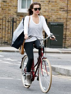 Star Tracks: Friday, May 23, 2014 | LIFE CYCLE | With a purse and extra-large shopping bag on her arm, Margot Robbie carefully maneuvers her bike through the streets of London on Thursday.