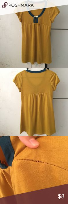 MAKE ME AN OFFER BUNDLE && SAVE ON SHIPPING Pre owned Mustard yellow & teal neck line shirt . . Has some undone stitching on the sleeves not noticed when used because it's inside the sleeve Tops Tunics
