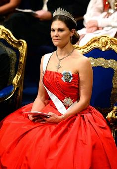 (L-R) Sweden's Queen Silvia, King Carl XVI Gustaf and Crown Princess Victoria attend the 2014 Nobel prize award ceremony at the Stockholm ...