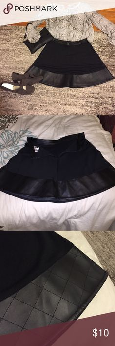 ⚡️Black Skirt ... Like new Black skirt with pleather tip and pleather stripped top. Zipper closure in back. Was given as a gift but was a bit too big. A great addition to your fall/winter wardrobe 💫⛄️🍂 Olsenboye Skirts