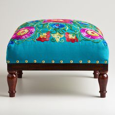 Great for a footstool in front of a cozy chair in our home office. Square Embroidered Upholstery Footstool | World Market