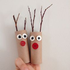 My kids made these easy finger puppets from toilet paper rolls, twigs, buttons, and black paint. Fun + easy!