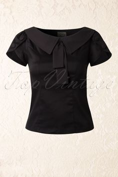 New collection ~ The40s Frou Frou Top in Blackby Banned is a playful top in vintage 40s - 50s style.Made from a stretchy cotton blend this fitted top will hug your curves beautifully! The striking neckline features a pointy vintage style collar with a fixed strap detail and flattering short sleeves with fake buttons. Finished off with a hidden zipper at the side. Slightly shorter style; perfect to pair with a high waist pencil skirt or pants!