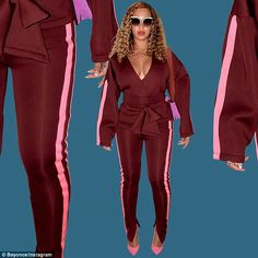 Hot mama! Her deep maroon jacket showed off just the right amount of cleavage and was cinched around her slender waist with an over-sized maroon belt