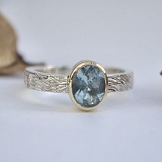 Aquamarine silver and gold ring wave texture
