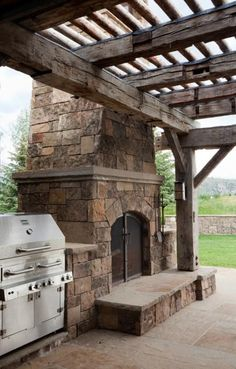 Good idea of rough sawn wood for pergola.  Reclaimed wooden pergola and patio at this western mansion.