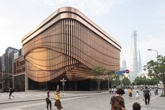 Images have emerged of a new arts and culture centre by Foster + Partners and Heatherwick Studio, which forms part of a new financial quarter in Shanghai