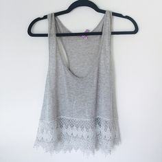 LF Grey Tank with Silver Lace Trim Size L but fits all sizes. The lace is high quality and more like the quality of embroidery. I am a S / M but got a Large to wear it like in the last picture. It is technically a crop top but not super short. The LF Brand is Emma & Sam. LF Tops Crop Tops
