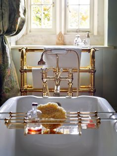 The master bathroom of Kate Moss's Cotswolds home features a range of classic pieces from Drummonds. The gleaming unlacquered brass reigns over the space with the timeless mull bath mixer, bath rack, and freestanding towel rail in the background. Kate Moss, Lustre Antique, Painted Wardrobe, Cast Iron Bath, Antique Wardrobe, Classic Baths, Vanity Basin, Roll Top Bath, Bath Shower Mixer