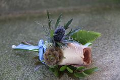like scabiosa seed head here - nice buttonhole for groom