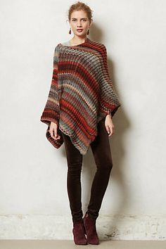 Poncho with leggings or skinny jeans and boots.