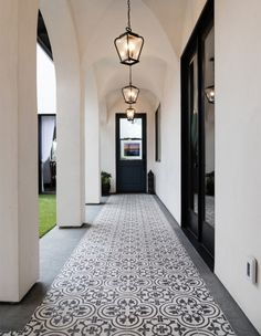 Granada Tile's classic Cluny tiles draw the eye down this long Moorish-inspired patio walkway. Informations About Trending Now: Dreamy Patios With Bold Patterned Tile Pin You can easily use my pro Porch Tile, Patio Tiles, Porch Flooring, Concrete Patio, Kitchen Flooring, Concrete Tiles, Outdoor Flooring, Garden Tiles, Flooring Ideas