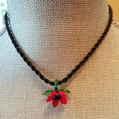 """🆕 Glass flower necklace Beautiful red glass flower pendant on a black silk cord.  Never been worn.  Pendant is 1""""x 1"""". Very detailed and delicate. Cord has knot closer.   Bundle discount available. Nonsmoking home. All reasonable offers accepted. handmade  Jewelry Necklaces"""