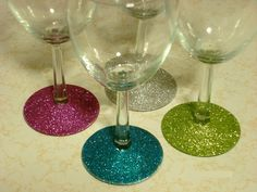 Glitter Wine Glasses  paint with mod podge, sprinkle with glitter, then seal with a clear coat of spray paint. The clear coat will make them washable.
