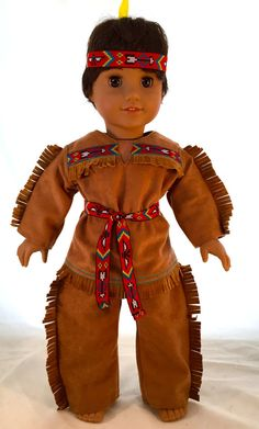 This doll is a former American Girl Doll which has been re wigged in a native American boys hair style. The costume is custom made and one of a