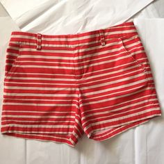 Tommy Hilfiger shorts! Tommy Hilfiger shorts!! Red and tan striped! Great condition! 2 pockets in front and back! Women's size 8. Inseam 4.5 inches. Length 13 inches! Great for summer and spring! Tommy Hilfiger Shorts