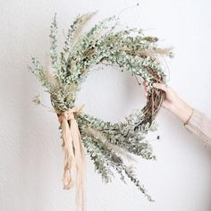 Lovely autumn wreath made with dried eucalyptus and grasses by Local Blooms, and adorned with peach plant dyed silk ribbon from The Poetry of Silk. Dried Flower Wreaths, Greenery Wreath, Dried Flowers, Floral Wreath, White Wreath, Diy Fall Wreath, Autumn Wreaths, Easter Wreaths, Christmas Wreaths