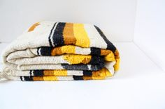 Vintage brown and yellow navajo aztec man bohemian Blanket/Rug. $65.00, via Etsy.