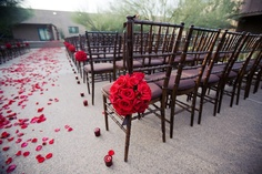 Red rose wedding ceremony pomanders with petals and candle decor, photo by Melissa Jill Photography - kissing balls!