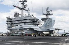 An F/A-18E Super Hornet assigned to the Pukin' Dogs of Strike Fighter Squadron (VFA) 143, lands on the flight deck of the aircraft carrier USS Harry S. Truman (CVN 75).