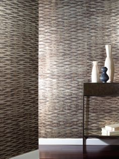 Bring the calming rhythm of water to the walls with the uniquely dramatic PISCES.  A multi-layer process of metallic and matte inks is hand applied by artisans to create a horizontal pattern that mimics the movement of rippling water.  With a range of dramatic and subtle colorations, go with the flow with PISCES.
