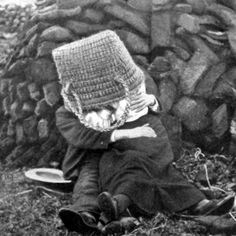 Old photograph of a couple courting behind a Peat Stack on the Isle of Skye, Inner Hebrides, Scotland