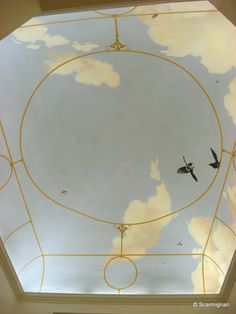 One of several ceilings that decorates by the Artist Scarmignan an old Italian palace. An opening painted on the ceiling allows you to enjoy the view of the skies and clouds on a clear day. www.scarmignan.com