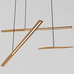 The Balance pendant is a thin steam bent timber LED light, which appeals as a single task light or in a cluster as feature lighting. The sliding counterweight allows the user to set light at the desired angle.