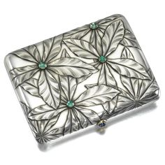 A FABERGÉ JEWELLED SILVER CIGARETTE CASE, MOSCOW, 1899-1908 the lid cast and chased with chestnut leaves and set with cabochon emeralds, cabochon sapphire thumbpiece, gilt interior