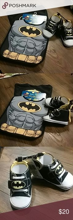 Batman matching bib and shoes set. 6-9 months Nwt. Amazing Batman bib with detachable cape and matching slide on shoes in size 6-9 months. Shoes have Batman logo velcro strap across the top. abg baby Matching Sets