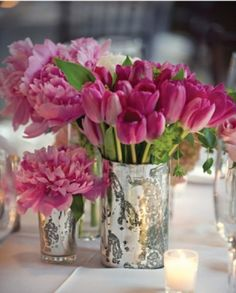 Love the vases as well as different flowers and height. More neutral colours though.