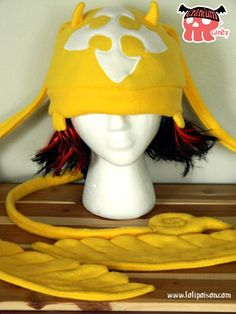 CRANIUM CANDY TIMCAMPY HATThis soft fleece cranium hat fits over most of your head comfortably. This design features the popular golden golem Timcampy from the anime/manga D. Gray Man.EACH HAT IS CUSTOM MADE TO ORDER SO WILL VARY SLIGHTLY FROM PHOTOGRAPHS.Made and ships within 2 - 3 weeks.