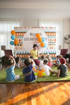 Festival themed birthday backdrop with decorative mini teepees at