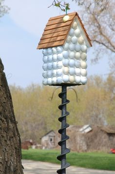 golfers birdhouse..mr. T has lots of old golf balls that he picks up on course !