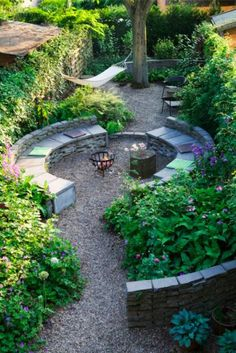 Round fire pit with path and greenery..