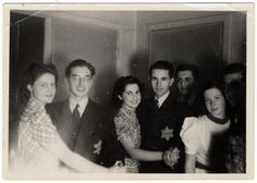 Jewish teenagers wearing Jewish stars dance at a party hosted by Rudy Acohen shortly before he was arrested in a reprisal action and sent to Auschwitz where he perished.