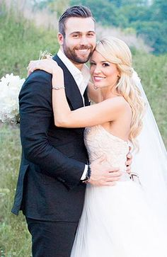 Former reality T.V. bachelorette, Emily Maynard, and her new husband, Tyler Johnson, on their wedding day, June 7, 2014. The couple met at church in the spring of 2012 and pursued their relationship after her engagement to Jef Holm, the bachelor she chose on the reality show ended in October 2012. She was also previously engaged to another T.V. bachelor, Brad Womack, and that engagement ended in 2011.