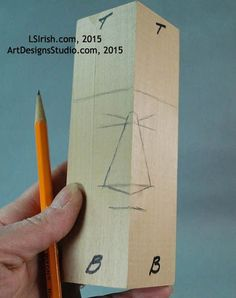 marking the guidelines for a wood spirit carving