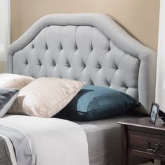 The Angelica features curved lines and lightly button tufts. This elegant piece can attach to almost any queen or full metal frame bed, as well as adjust according to the height of your mattress.