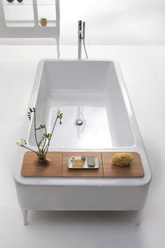 unique free-standing tub with built in storage and furniture style feet [bisazza collection]