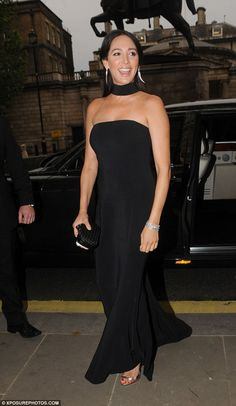 Glam: Lauren dazzled in a floor-length black dress and matching choker, adding a bit of expensive sparkle to her outfit with a pair of show-stopping diamond drop earrings and a diamond bracelet