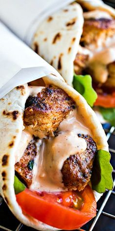 Grilled Lemon Chicken Flatbread wraps with spicy garlic sauce. This is loaded with different flavors and a great dish to try with you and the family.