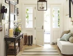 Pottery Barn entryway inspiration.  The Paxton Slipcovered Bench featured here with the pile of pillows is a lovely welcome to all who enter.