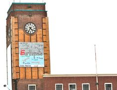 The clock on the old railway station tower stopped on 4.35am with an earthquake poster in memory of the September 7.1
